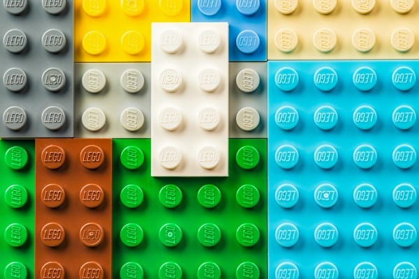 Edinburgh, UK - February 19, 2016: A macro image of Lego pieces arranged together. Lego branding is visible on each raised circle. A macro image of the surface of several pieces of Lego.